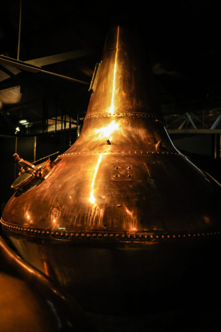 Dublin, Eire - November 18, 2013: Copper fermentation vat at an Irish Whiskey distillery